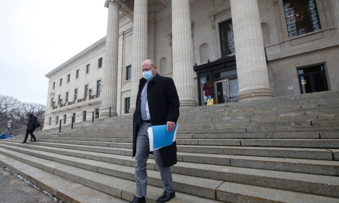 Dr. Brent Roussin, Manitoba chief public health officer, leaves after speaking at the province's latest COVID-19 update at the Manitoba legislature in Winnipeg on Oct. 30, 2020. (The Canadian Press/John Woods)