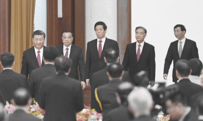 Chinese leader Xi Jinping (L), Premier Li Keqiang (2nd L), and Politburo Standing Committee members (L-R) Li Zhanshu, Wang Yang, and Wang Huning arrive for a reception at the Great Hall of the People in Beijing on Sept. 30, 2020. (GREG BAKER/AFP via Getty Images)