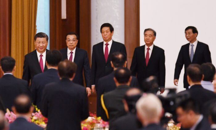Chinese leader Xi Jinping (L), Premier Li Keqiang (2nd L), and Politburo Standing Committee members (L-R) Li Zhanshu, Wang Yang, and Wang Huning arrive for a reception at the Great Hall of the People in Beijing, China, on Sept. 30, 2020. (Greg Baker/AFP via Getty Images)