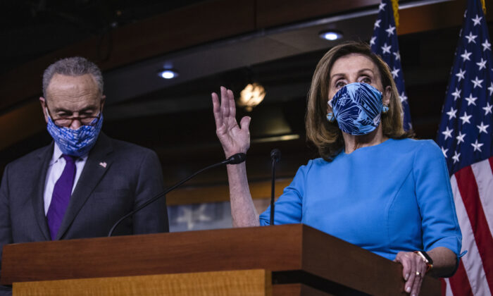 Speaker of the House Nancy Pelosi (D-Calif.) speaks alongside Senate Minority Leader Chuck Schumer (D-N.Y.) during a joint press conference at the U.S. Capitol in Washington, on Nov. 12, 2020. (Samuel Corum/Getty Images)