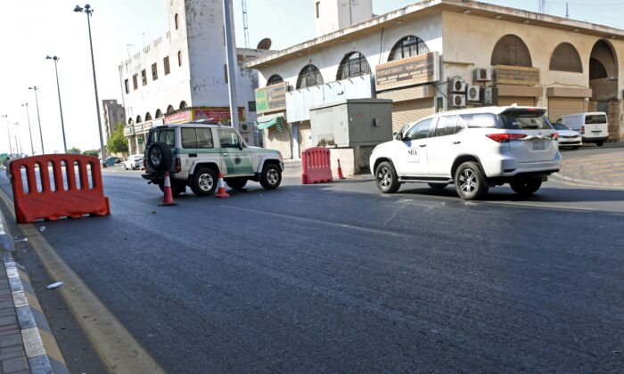 Saudi police close a street leading to a non-Muslim cemetery in Jeddah, where a bomb struck a World War I commemoration attended by European diplomats, on Nov. 11, 2020. (AFP via Getty Images)
