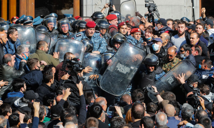 People argue with police during a protest against an agreement to halt fighting over the Nagorno-Karabakh region, in Freedom Square in Yerevan, Armenia on Nov. 11, 2020. (Dmitri Lovetsky/AP)