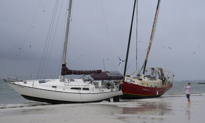 Boats sit on the beach in the aftermath of Tropical Storm Eta, in Gulfport, Fla., on Nov. 12, 2020. (Lynne Sladky/AP Photo)