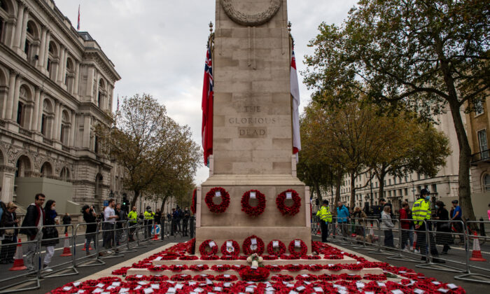 Members of the public gather to look at wreaths left following the National Service of Remembrance at The Cenotaph on Nov. 8, 2020 in London, England. (Chris J Ratcliffe/Getty Images)