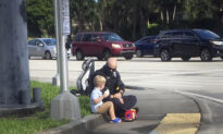 Candid Photo of Cop Comforting Kid After Car Accident Reveals 'Act of Kindness'
