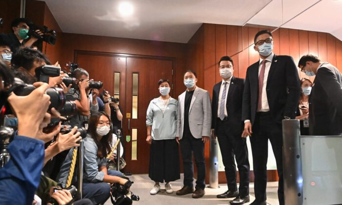 (L-R) Pro-democracy lawmakers Helena Wong, Wu Chi-wai, Andrew Wan, and Lam Cheuk-ting arrive at Hong Kong's Legislative Council to submit their resignation letters on Nov. 12, 2020. (Song Bilung/The Epoch Times)