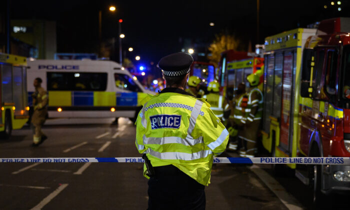 Police officers secure the cordon around Edmonton Green police station, following an incident involving a car colliding with the front doors of the building in the Edmonton area of London on Nov. 11, 2020. (Leon Neal/Getty Images)