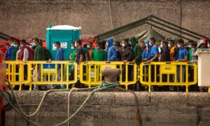 Tensions in Packed Migrant Shelter on Spain's Canary Islands