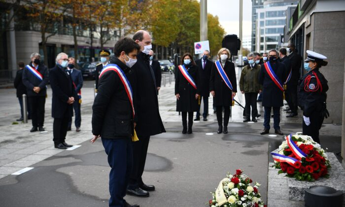 Saint-Denis Mayor Mathieu Hanotin (L), French Prime Minister Jean Castex (C) and Paris Mayor Anne Hidalgo (3rdR) pay tribute to victim of the 2015 Paris attacks outside the Stade de France stadium in Saint-Denis on Nov. 13, 2020. (Christophe Archambault/Pool/AFP via Getty Images)