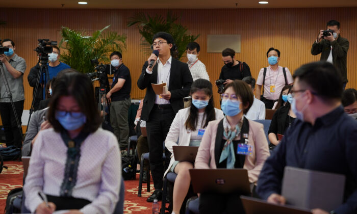 Journalists attend a video press conference that was hosted by Chinese Foreign Minister Wang Yi in Beijing, China on May 24, 2020. (Andrea Verdelli/Getty Images)