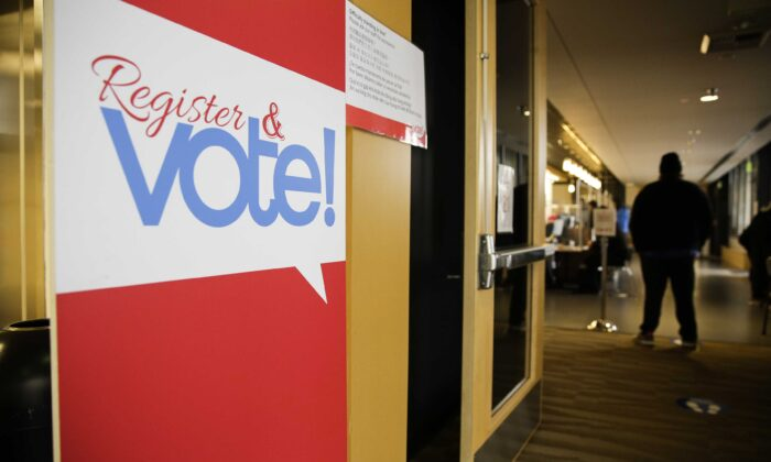 A sign for voter registration is pictured on Election Day at the King County Elections office in Renton, Wash., on Nov. 3, 2020. (Jason Redmond/AFP via Getty Images)
