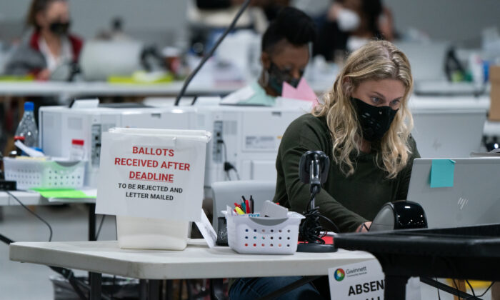 Election personnel check in provisional ballots at the Gwinnett County Board of Voter Registrations and Elections offices in Lawrenceville, Ga. on Nov. 7, 2020. (Elijah Nouvelage/Getty Images)