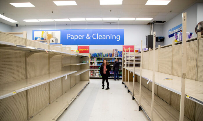 The toilet paper aisle is seen empty as people shop at a Walmart Supercenter amid coronavirus fears spreading in Toronto, Ontario, Canada, on March 13, 2020. (Carlos Osorio/File Photo/Reuters)