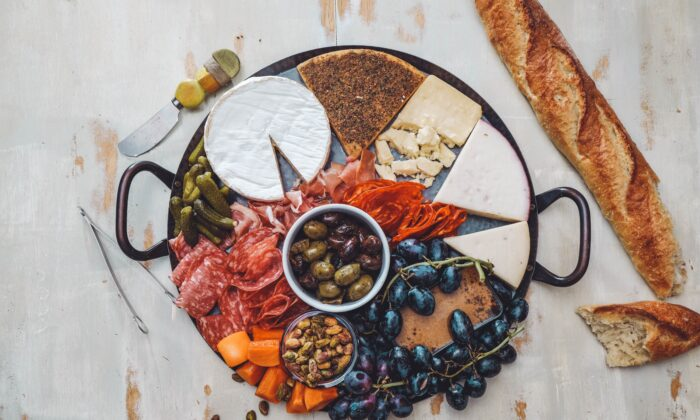 Everything you need for a cheese board can be purchased ahead, ready to prepare, and arranged with simple tips.  (Erik Dungan/Unsplash)
