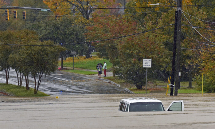 A vehicle is submerged in floodwater on Freedom Drive in Charlotte, N.C., on Nov. 12, 2020. (Jeff Siner/The Charlotte Observer via AP)