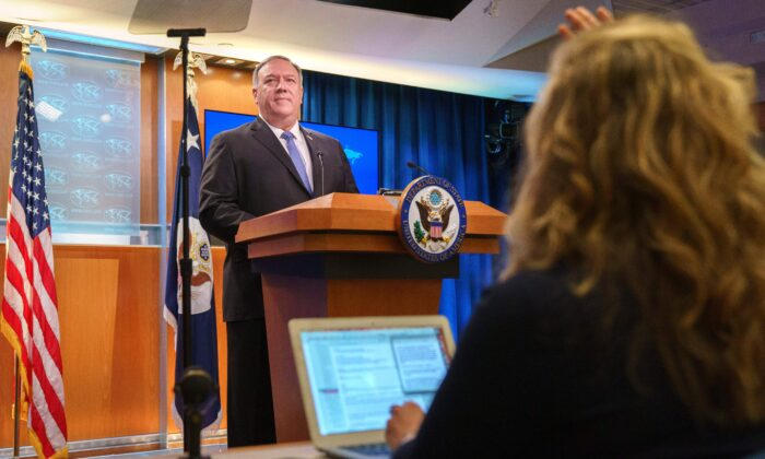 Secretary of State Mike Pompeo calls on a reporter while speaking about the counting of votes in the US election during a briefing, at the State Department in Washington, on Nov. 10. 2020. (Jacquelyn Martin / Pool / AFP via Getty Images)