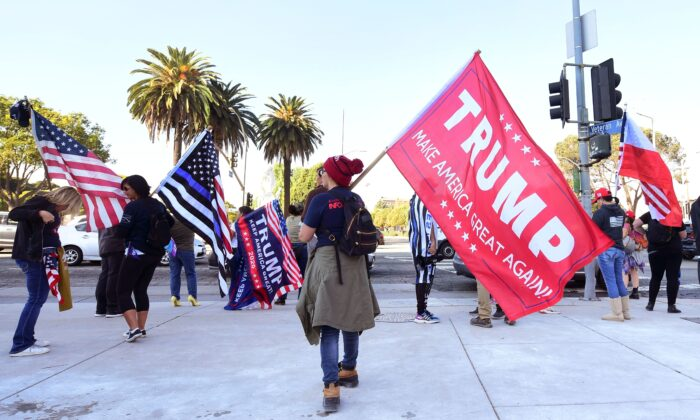 Supporters of President Donald Trump hold a rally on Veteran's Day in Los Angeles, Calif., on Nov. 11, 2020. (Photo by Frederic J. Brown/AFP via Getty Images)