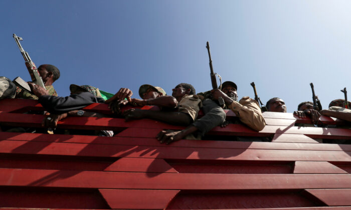 Members of Amhara region militias ride on their truck as they head to the mission to face the Tigray People's Liberation Front (TPLF), in Sanja, Amhara region near a border with Tigray, Ethiopia Nov. 9, 2020. (Tiksa Negeri//Reuters, File Photo)