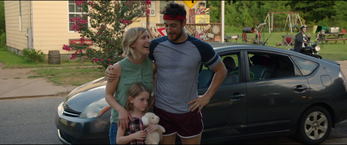 """mom, daughter, and dad in front of car in """"Small Group the Movie"""""""