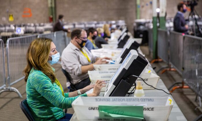 Poll workers tabulate ballots at the Allegheny County Election Warehouse after the election in Pittsburgh, Pa., on Nov. 6, 2020. (John Altdorfer/Reuters)
