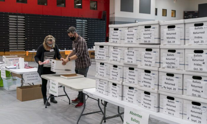 Poll workers check-in a box of absentee ballots at Sun Prairie High School in Sun Prairie, Wis., on Nov. 3, 2020. (Andy Manis/Getty Images)