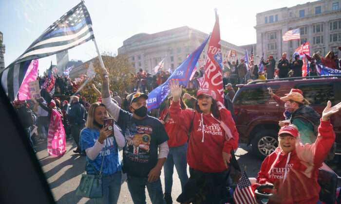 Supporters cheer as the motorcade carrying President Donald Trump passes by Freedom Plaza in Washington on Nov. 14, 2020. (Mandel Ngan/AFP via Getty Images)