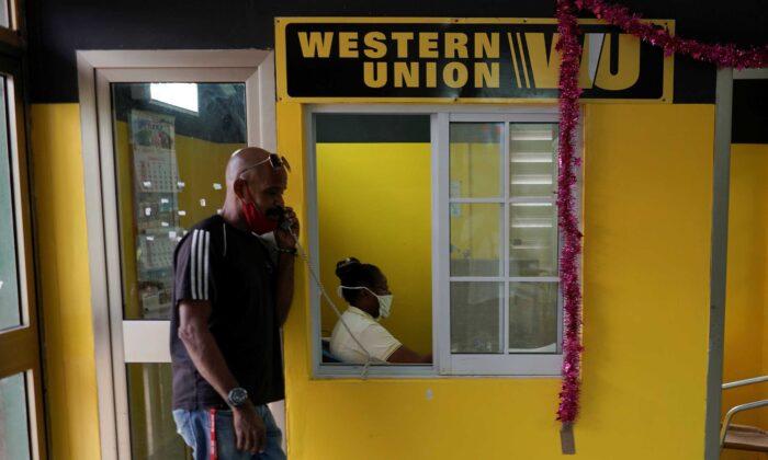 A man talks on the phone outside a Western Union office, in Havana, Cuba, on Oct. 28, 2020. (Alexandre Meneghini/Reuters)