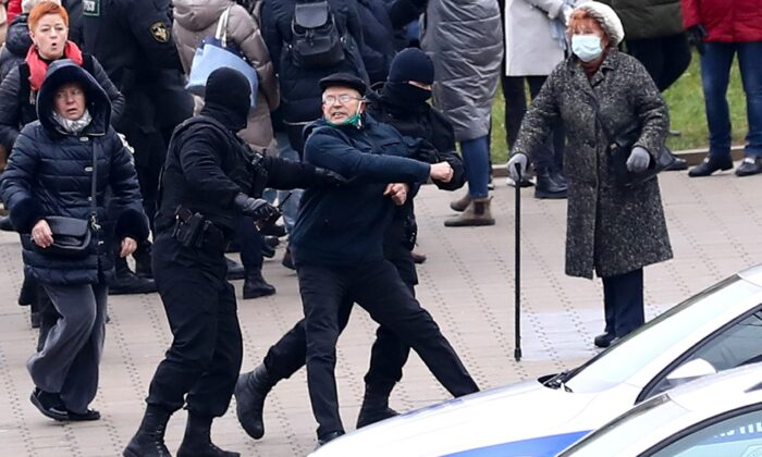 Belarusian riot police detain demonstrators during an opposition rally to protest the official presidential election results in Minsk, Belarus, on Nov. 15, 2020. (AP Photo)