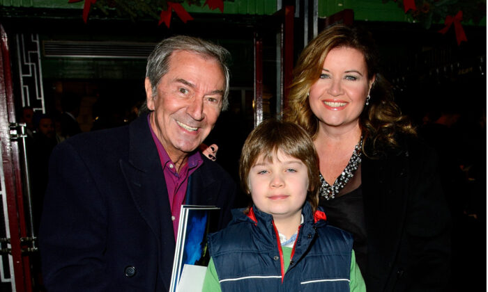 "Des O'Connor, Jodie Brooke Wilson, and Adam O'Connor attend the press night for ""Wicked"" at Apollo Victoria Theatre in London, on Dec. 19, 2013. (Ben A. Pruchnie/Getty Images)"