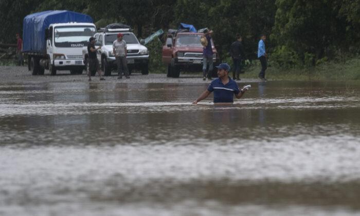 A man walks through a flooded road in Okonwas, Nicaragua, on Nov. 4, 2020. (Carlos Herrera/AP Photo)
