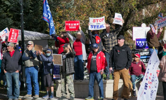 """People hold signs at the """"Stop the Steal"""" rally near the Nevada State Capitol in Carson City, Nev., on Nov. 14, 2020. (Mark Cao/NTD)"""