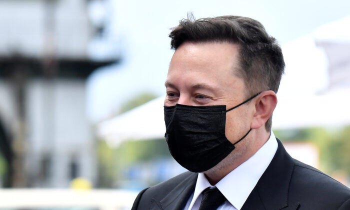Elon Musk wears a protective mask as he arrives to attend a meeting with the leadership of the conservative CDU/CSU parliamentary group, in Berlin, Germany, on Sept. 2, 2020. (Tobias Schwarz/Pool via REUTERS)