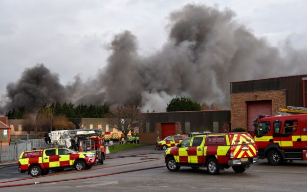 Fire fighters are seen attending a blaze involving a large quantity of tyres at a location near the railway's Bradford Interchange in Bradford on Nov.16, 2020. (West Yorkshire Fire & Rescue Service)