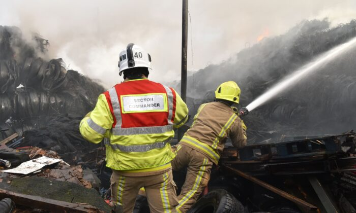 Fire fighters are seen tackling a blaze involving a large quantity of tyres at a location near the railway's Bradford Interchange in Bradford, Northern England, on Nov. 16, 2020. (West Yorkshire Fire & Rescue Service)