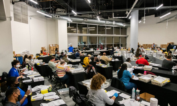 Employees of the Fulton County Board of Registration and Elections process ballots in Atlanta, Ga., on Nov. 4, 2020. (Brandon Bell/Reuters)