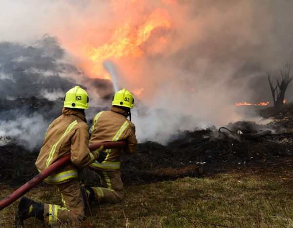 Fire fighters are seen tackling a blaze involving a large quantity of tyres at a location near the railway's Bradford