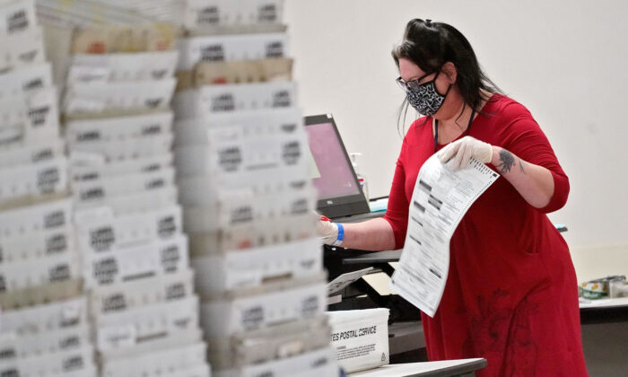 Arizona elections officials continue to count ballots inside the Maricopa County Recorder's Office in Phoenix on Nov. 6, 2020. (Matt York/AP Photo)