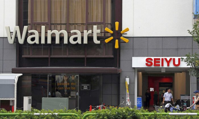 Company signs of Walmart and Seiyu are seen in Tokyo on July 12, 2018. (Kyodo News via AP)