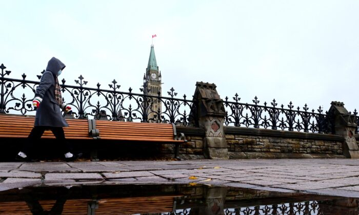The Peace Tower is seen above the fence that borders Parliament Hill in Ottawa on Oct. 20, 2020. (The Canadian Press/Sean Kilpatrick)