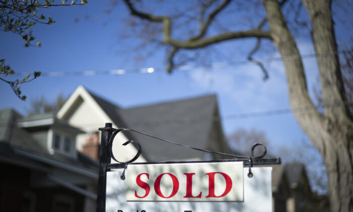 A real estate sold sign is shown in a Toronto west end neighbourhood, on May 17, 2020. (The Canadian Press/Graeme Roy)