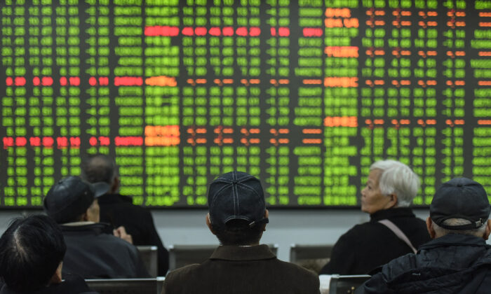 Investors look at a screen showing stock market movements at a securities company in Hangzhou in China's eastern Zhejiang province on Feb. 3, 2020. (STR/AFP via Getty Images)