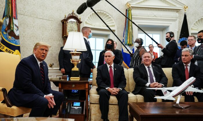 Former President Donald Trump talks to reporters while hosting Iraqi Prime Minister Mustafa Al-Kadhimi (not pictured), and (L-R) Vice President Mike Pence, Secretary of State Mike Pompeo, and National Security Advisor Robert O'Brien in the Oval Office at the White House in Washington, DC on Aug. 20, 2020. (Anna Moneymaker-Pool/Getty Images)