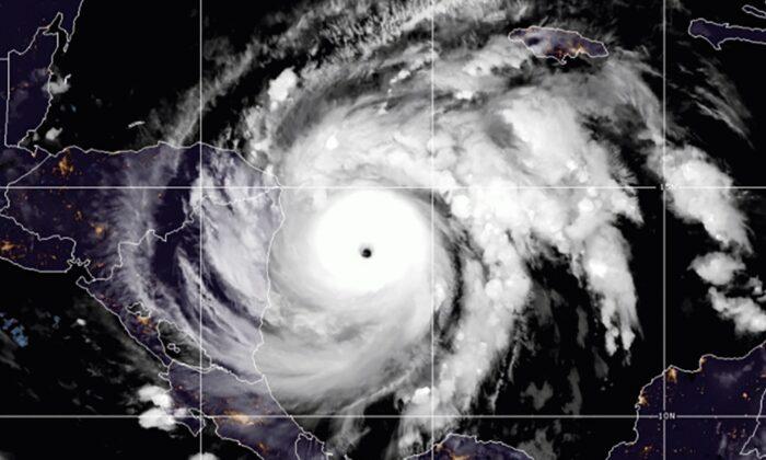 This satellite image shows Hurricane Iota in the North Atlantic Ocean at 07:11 EST, on Nov. 16, 2020. (NOAA via AP)