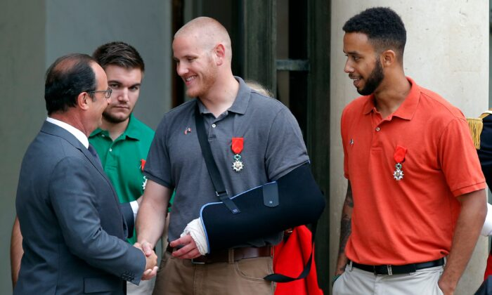 French President Francois Hollande bids farewell to U.S. Airman Spencer Stone, U.S. National Guardsman Alek Skarlatos (second from left), and Anthony Sadler (R), a senior at Sacramento State University in California, after Hollande awarded them the French Legion of Honor at the Elysee Palace, in Paris, on Aug. 24, 2015. (Michel Euler/AP Photo)