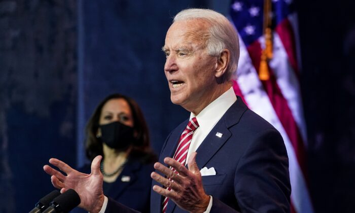 Democratic presidential nominee Joe Biden speaks about the U.S. economy as his running mate, Sen. Kamala Harris (D-Calif.), stands by following their briefing with economic advisers in Wilmington, Del., on Nov. 16, 2020. (Kevin Lamarque/Reuters)