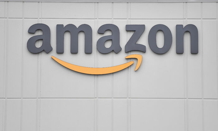 The logo of U.S. online retail giant Amazon is seen at the distribution center in Staten Island, N.Y., on March 30, 2020. (Angela Weiss/AFP via Getty Images)