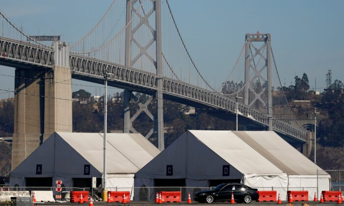 Tents from a COVID-19 testing site sit in front of the San Francisco-Oakland Bay Bridge in San Francisco, Calif., on Nov. 16, 2020. (Jeff Chiu/AP Photo)