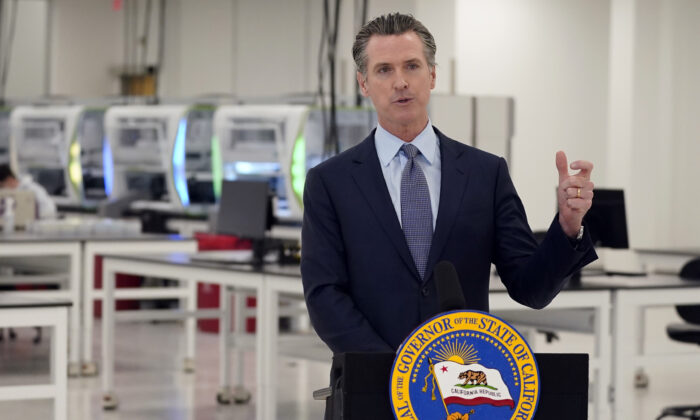 California Gov. Gavin Newsom speaks at a COVID-19 testing facility in Valencia, Calif. on Nov. 16, 2020. (Marcio Jose Sanchez/Pool-AP Photo)