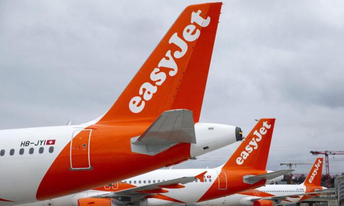 File photo shows a large number of easyJet aircraft parked on the tarmac of the Geneve Aeroport, in Geneva, Switzerland, on March 30, 2020. (Salvatore Di Nolfi/Keystone via AP)