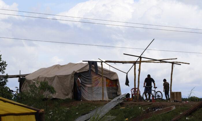 People living under precarious conditions make preparations before Hurricane Iota makes landfall in San Manuel Cortes, Honduras on Nov. 16, 2020. (Delmer Martinez/AP Photo)